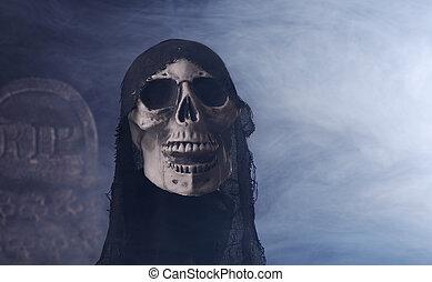 Grim Reaper - Halloween grim reaper prop on a smoky...