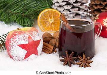 Winter apple fruit and mulled wine alcohol drink on...