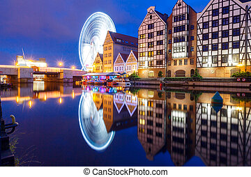 Poland. Gdansk. Quay center channel. - Night view of the old...