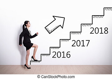 Business woman success in new year - Business woman stepping...