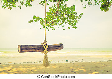 A swing on the beach ( Filtered image processed vintage...