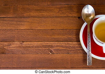 The Time of Tea Break on the table top view. Wooden vintage table with cup with copy space