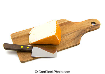 Port salut - French cheese on a plate isolated over white