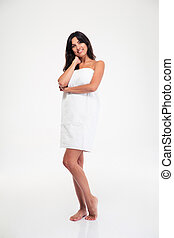 Happy beautiful woman standing in towel