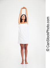 Happy woman in towel stretching hands