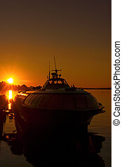 Silhouette of ship in city port - Silhouette of hydrofoil...