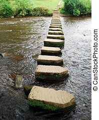 Stepping stones - Upright view of stepping stones crossing...