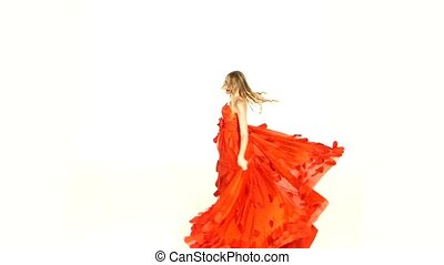 Beautiful girl in gorgeous red dress whirling - Beautiful...