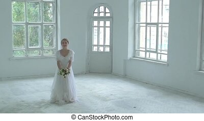 Beautiful girl in white dress throw up the bouquet, slow...