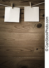 Blank Reminder Notes Pegged on String against Wood Planks
