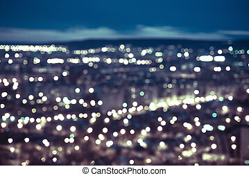 abstract blue circular bokeh background, city lights in the...