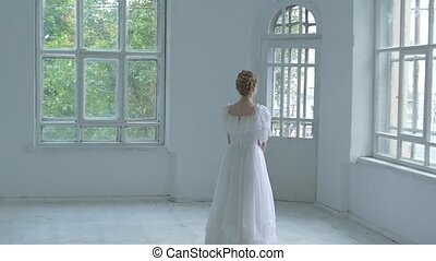 Beautiful girl in white dress throw back the bouquet, slow...