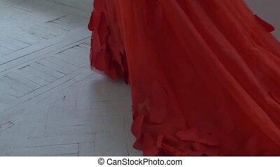 Beautiful girl in gorgeous red dress with hemline continue...