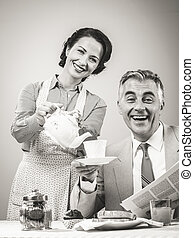 1950s style couple having breakfast - 1950s beautiful woman...