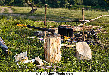 chopper and fuelwood, campfire and food on halt in walking...