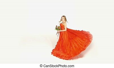 Beautiful girl in gorgeous red dress with bouquet of flowers...