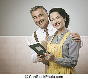 Wife and husband reading a cookbook together - Vintage wife...