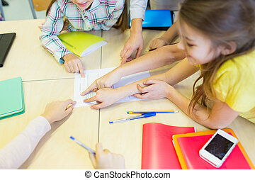 group of school kids pointing fingers to test - education,...