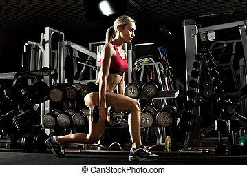 fitness girl in gym - beautiful girl bodybuilder , execute...