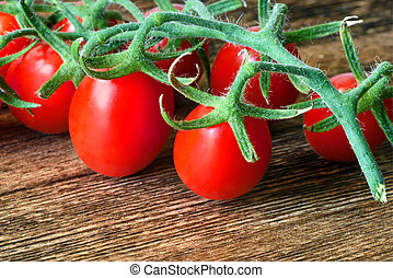 Tomato - A closeup of small red tomatoes A cluster of...