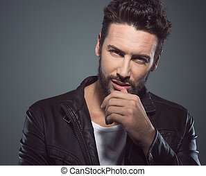 Cool attractive man in leather jacket - Cool seductive man...