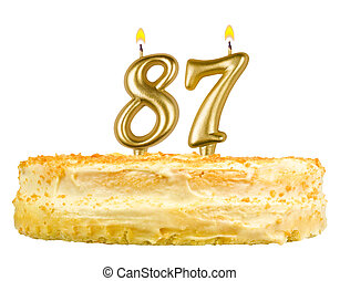birthday cake with candles number eighty seven isolated on...