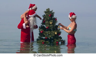 Family Christmas tropical beach vacation father as Santa...