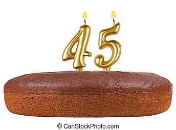 birthday cake with candles number 45 isolated on white...