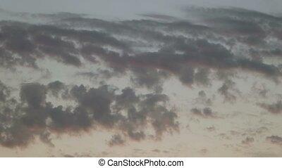 Dark  sunset sky. Vanishing clouds