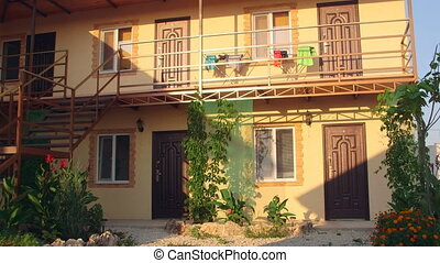 Small cheap resort hotel exterior in summer