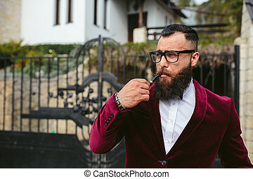 rich man with a beard smokes cradle - a rich man in a jacket...