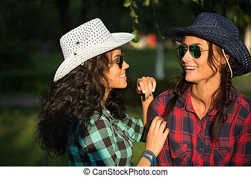 sexy girl in cowboy hats and plaid shirts sunglasses - Two...