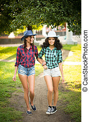 sexy girl in cowboy hats and plaid shirts - Two sexy young...
