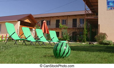 Small family run tourist hotel exterior with patio area in...