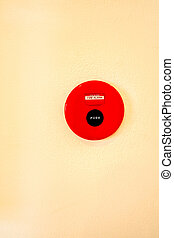 Red fire alarm on wall