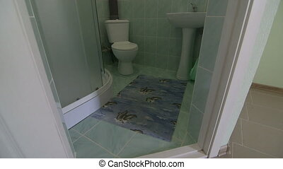 Bathroom with toilet sink and shower in cheap budget hotel...