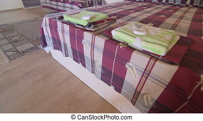 Cheap budget hotel room interior with two beds and bathroom