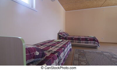 Cheap budget hotel room interior with two beds and bathroom...