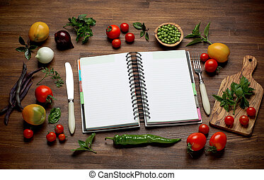 Fresh Organic Vegetables and Spices on a Wooden Background and Paper for Notes. Open Notebook. Diet. Dieting