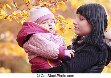 Mother and Child in yallow autumn forest