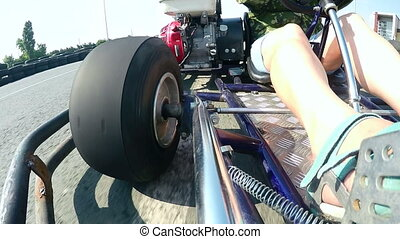 Karting driver rushes on kart circuit outdoor