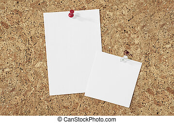 paper notes on cork background - di