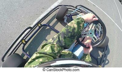 Karting driver rushes recreational go-kart on kart track...
