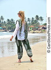 Young woman in the traditional punjabi dress on Patnam beach...