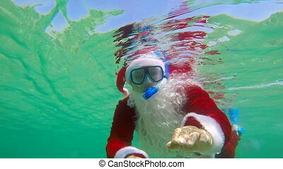 Santa Claus coming on Christmas day under water
