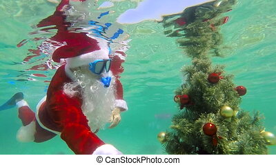 Christmas celebration underwater scuba Santa installs...