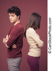 Young couple arguing - Young sad couple arguing and standing...