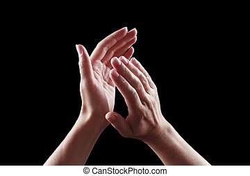 beautiful female hands isolated on black background applause...