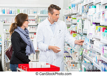 Pharmacist Removing Medicine For Customer