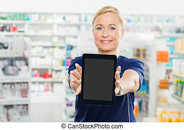 Female Pharmacist Showing Digital Tablet With Blank Screen -...